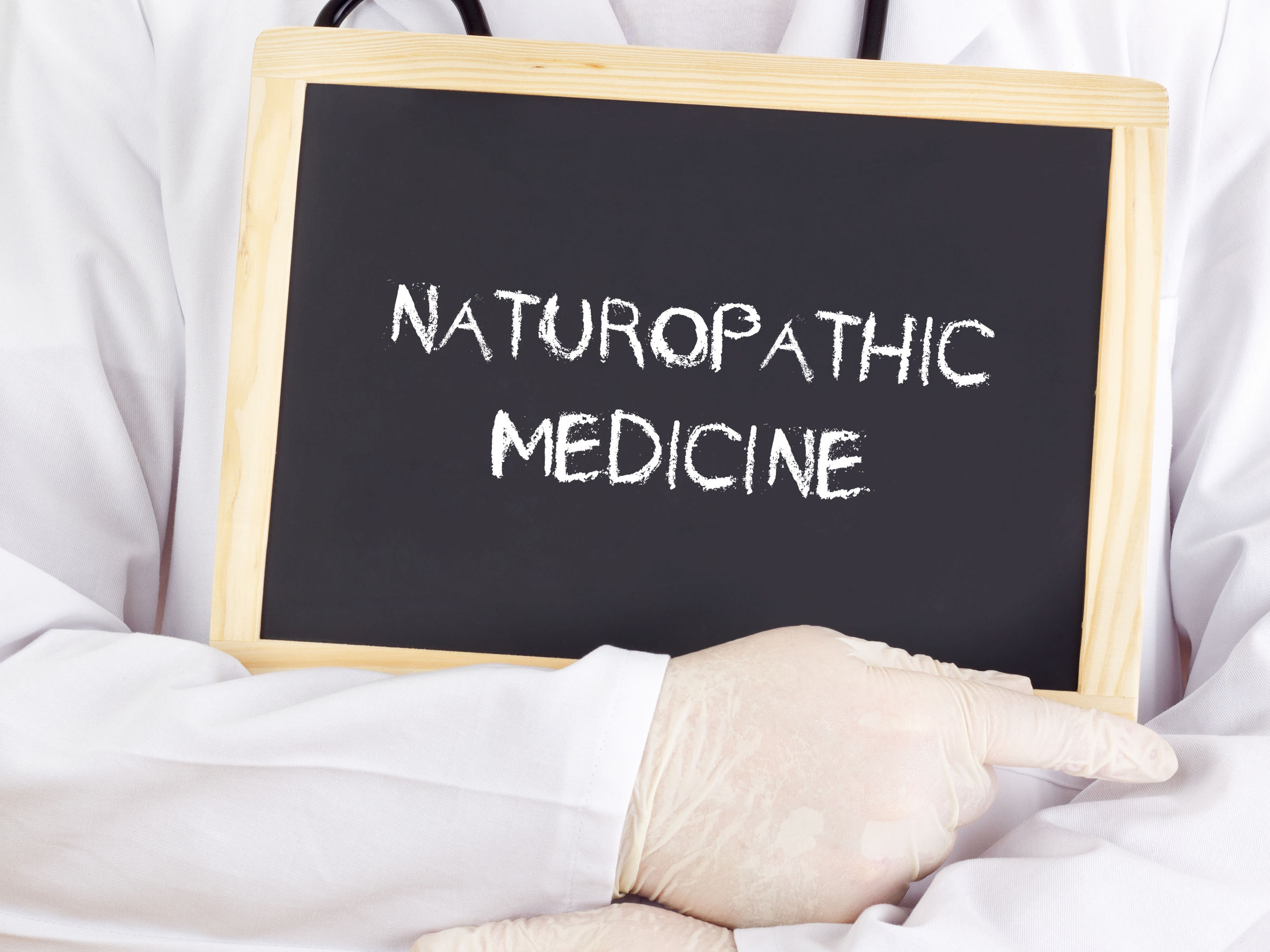 39279617 - doctor shows information: naturopathic medicine