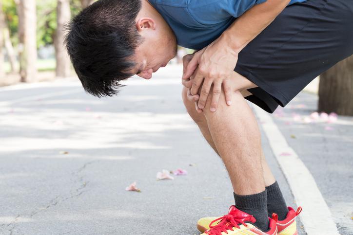 Man having knee pain while exercising